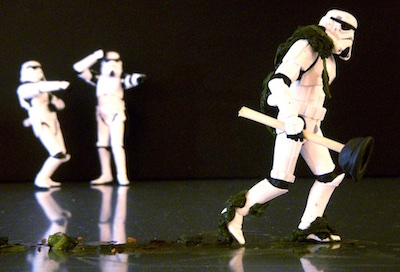 Two Star Wars Stormtroopers laugh at one who's had to plunge a toilet